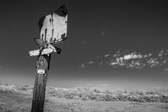 Rusty Street sign, black and white. A blank, rusted street sign on a wooden pole near the Salt Lake City, Utah, black and white photography Stock Photos