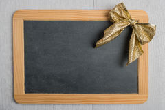 Blank rustic Christmas chalkboard slate with lace stock photo