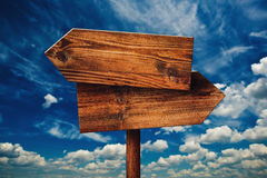 Free Blank Rustic Opposite Direction Wooden Sign Against Clouds Royalty Free Stock Image - 58100926