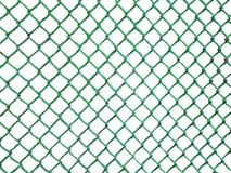 Blank rusty Metal Fence net mesh on dark green plain background Seamless Chainlink Fence. Blank rusty green Metal Fence net. Seamless isolated Chainlink Fence Stock Image