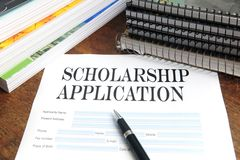 Blank scholarship application on desktop Stock Image