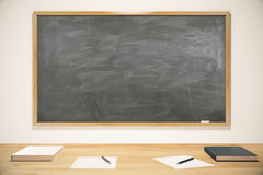 Blank school blackboard with books, exercise books and pens Stock Photography