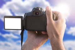 Blank screen on camera. Man holding camera with blank screen and take a photo Stock Photography