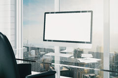 Blank screen of computer monitor on glassy table. Mock up royalty free stock photos