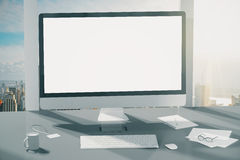 Blank screen of computer monitor, keyboard, cup of coffee and gl Royalty Free Stock Photo