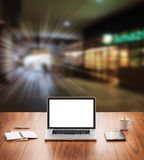 Blank screen laptop computer. With blur coffee shop background Stock Photos