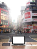 Blank screen Laptop computer. Laptop computer with Shinjuku street background Stock Photography