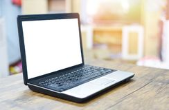 Blank screen laptop on workspace desk wooden royalty free stock images