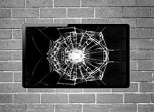 Blank screen LCD tv with broken screen hanging on a wall Royalty Free Stock Photo