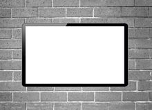 Blank screen LCD tv hanging on a wall Royalty Free Stock Photography