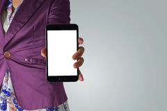 Blank screen mobile phone with woman hand. Blank screen mobile phone, with woman hand, dressed in violet jacket Stock Photography