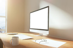 Blank screen of monitor with cup of coffee, glasses and keyboard Royalty Free Stock Images