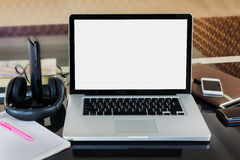 Blank screen notebook computer or laptop on working table Royalty Free Stock Photography