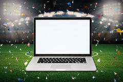 Blank screen notebook with soccer stadium background Royalty Free Stock Image