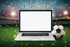 Blank screen notebook with soccer stadium background Royalty Free Stock Photo