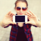Blank screen phone, woman makes self-portrait on the smartphone Stock Images