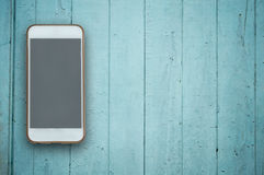 Blank screen phone on wood background. Royalty Free Stock Photography