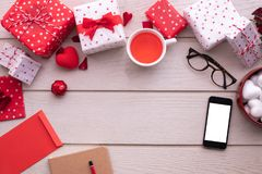 Blank screen smartphone, cell phone, tablet with Valentines Day Decoration set, Valentine`s Day celebration background. Top view stock photo