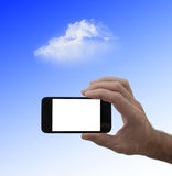 Blank screen smartphone in male hand, and cloud Royalty Free Stock Photos