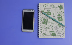 Blank screen Smartphone. With pencil and notebook stock images