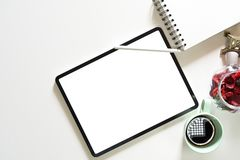 Blank screen tablet on desktop in graphic design studio. Mockup blank screen modern tablet for sketch design on white workspace and copy space stock photography