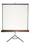 Blank screen on a tripod. Old blank presentation, slides, movie or projector roller screen on a tripod Stock Photography