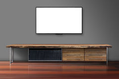 Blank screen tv on concrete wall with wooden table stock images