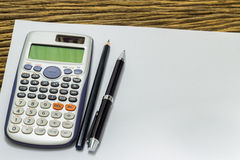 Blank sheet of calculator pens and pencil Stock Photos