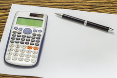 Blank sheet of calculator pens and pencil Royalty Free Stock Photo