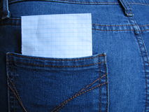 Blank sheet in a clothing pocket. For notes or inscriptions stock photography