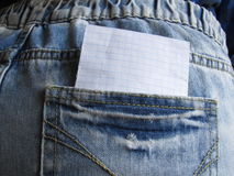 Blank sheet in a clothing pocket. For notes or inscriptions royalty free stock photos
