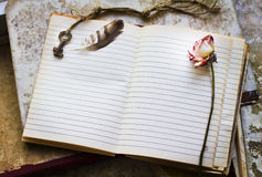 Blank sheet with key, feather and rose Stock Photos