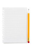 Blank sheet of notebook background. Blank sheet of notebook and yellow pencil isolated on white background Stock Photography
