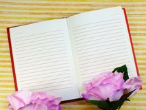 Blank sheet of notebook and beautiful bouquet flowers stock photos