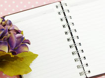 Blank sheet of notebook and red and beautiful hydrangea of artificial flowers Stock Image