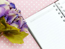 Blank sheet of notebook and red and beautiful hydrangea of artificial flowers Royalty Free Stock Images