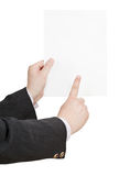 Blank sheet of paper in businessman hand Stock Images