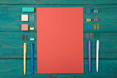 Blank sheet of paper and colorful office accessories Royalty Free Stock Photography