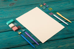 Blank sheet of paper and colorful office accessories Stock Photos