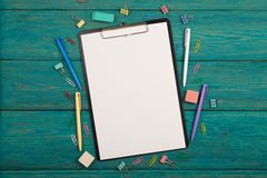 Blank sheet of paper and colorful office accessories Royalty Free Stock Photos