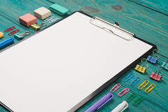 Blank sheet of paper and colorful office accessories Stock Photography