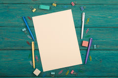 Blank sheet of paper and colorful office accessories Royalty Free Stock Photo
