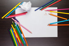 Blank sheet of paper with colorful pencils royalty free stock photography