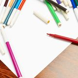Blank sheet of paper covered with markers Royalty Free Stock Photos