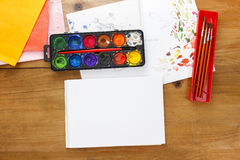 Blank sheet of paper and drawing accessories. Stock Photos