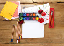Blank sheet of paper and drawing accessories Royalty Free Stock Images
