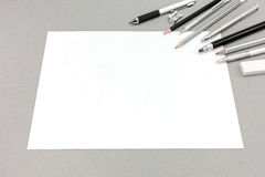 Blank sheet of paper and drawing accessories on gray background Stock Photography