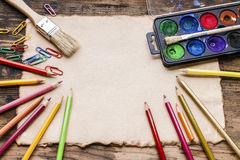 Blank sheet of paper and drawing accessories. Royalty Free Stock Photo