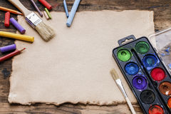 Blank sheet of paper and drawing accessories. Royalty Free Stock Photos