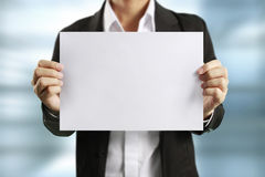 Blank sheet of paper in  hand Stock Photos